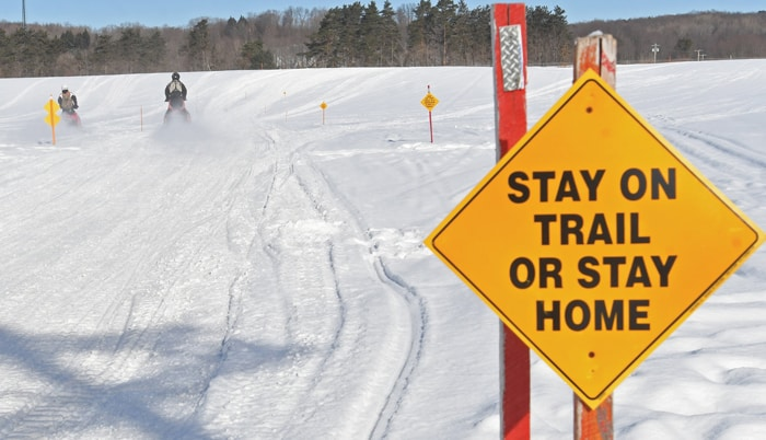 Snowmobile Trespassing, stay on trail or stay home